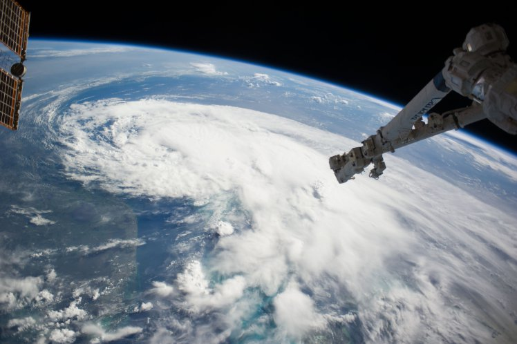 IN SPACE - JULY 2: In this handout provided by NASA from the the Earth-orbiting International Space Station, weather system Arthur travels up the east coast of the United States in the Atlantic Ocean near Florida on July 2, 2014 in space. The robotic arm of the Space Station Remote Manipulator System or Canadarm2 is seen at upper right. According to reports, Arthur has begun moving steadily northward at around 5 kt. and the tropical storm is expected to strike the North Carolina Outer Banks over the Fourth of July holiday.   (Photo by NOAA via Getty Images)